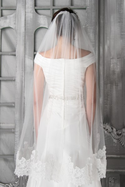 """If you prefer a shorter veil, 45"""" is the perfect choice, particularly with an A-line or full-skirted wedding dress.This one-tier bridal veil has stunning lace detailing for added interest."""