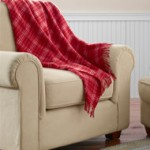Plaid throws for fall sports fans. This plaid throw from LL Bean is made of washable wool and retails for $89.