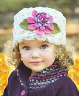 The Gabby Winter Hat from Tuff Kookooshka is so sweet and is handcrafted in the USA! It's just one of dozens of charming winter hats for kids by made by the company.
