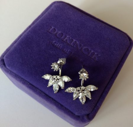 The earrings are beautifully crafted from 18K white gold plate over .925 sterling silver. And, the pieces feature sparkling cz stones in both brilliant and marquis cuts.
